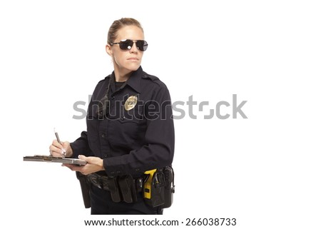 Police officer in sunglasses writing report - stock photo