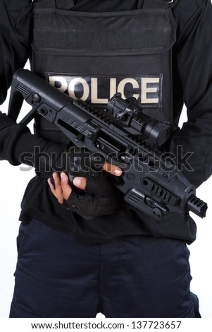Police officer is holding with a rifle - stock photo
