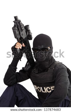 Police officer is holding with rifle on white background - stock photo