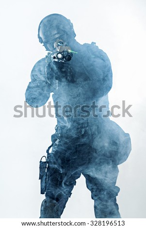 police officer SWAT in black uniform and face mask studio shot - stock photo