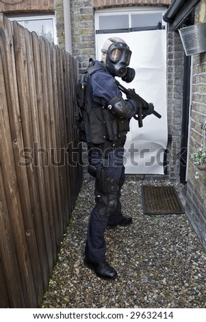 police officer with machine gun - stock photo