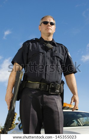 Police Officer with Shotgun - stock photo