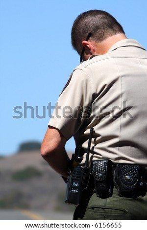 Police officer writing a ticket - stock photo