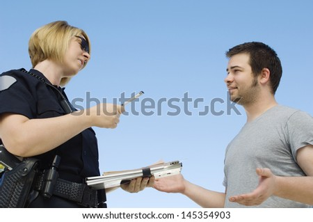 Police Officer Writing Ticket - stock photo