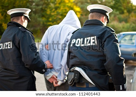 Police officers are arresting a criminal - stock photo