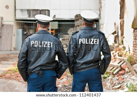 Police officers are showing their back - stock photo