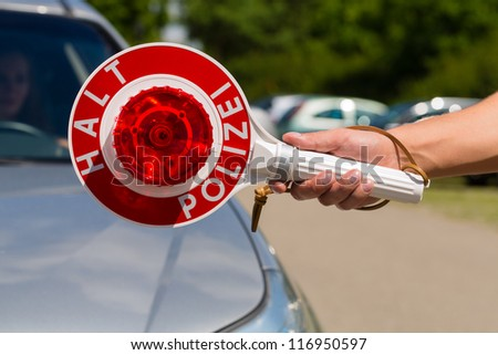 Police - policeman or cop in uniform stop car in traffic control - stock photo