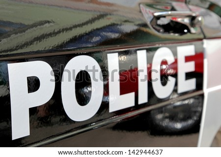 Police - sign on the old car - stock photo