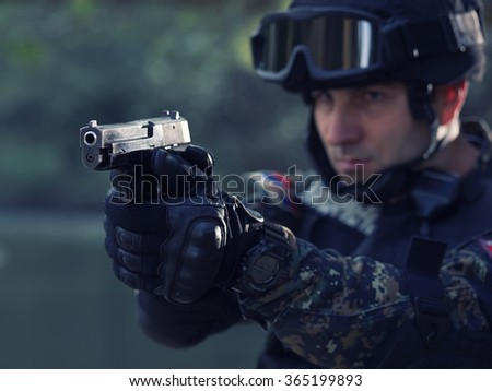 Police special forces, under exposed photo and colored.National flag on his arms - stock photo