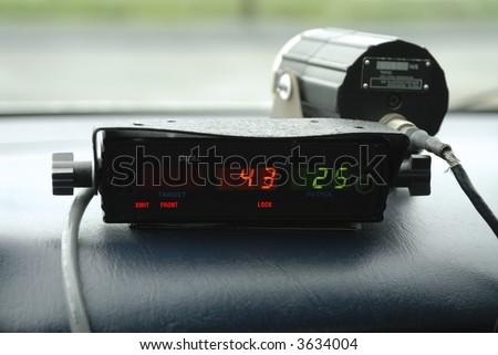 Police speed radar unit in police car. - stock photo