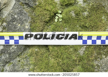 Police tape trespassing in portugal, safety - stock photo