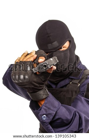Policeman in black mask targeting with a handgun - stock photo