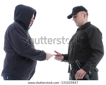 Policeman in black uniform checking ID of hooded suspect, shot on white - stock photo