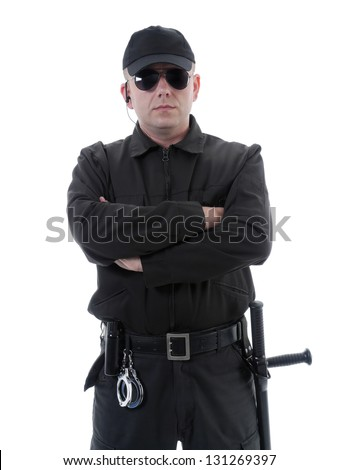 Policeman or security guard wearing black uniform and glasses standing confidently with folded arms, shot on white - stock photo