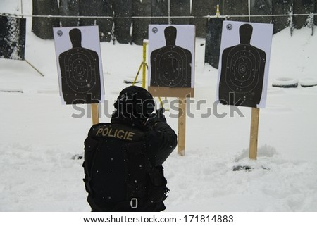 Policeman special unit headed to the shooting range target - stock photo