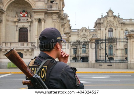 Policeman standing near Government Palace in Lima, Peru. Peruvian National Police is one of the largest police forces in South America. - stock photo