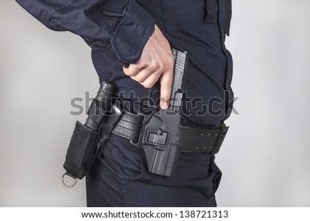 Policeman with gun - stock photo
