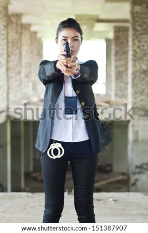 Policewoman in action. - stock photo