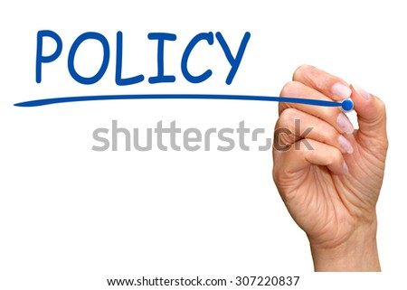 Policy - female hand with pen writing blue text on white background - stock photo