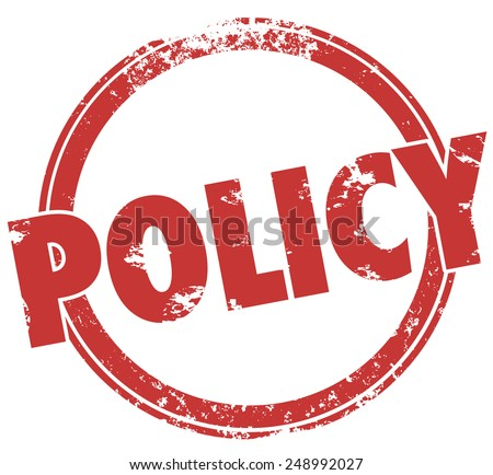Policy word in round, red ink stamp to illustrate the need to follow rules, guidelines, laws and regulations for compliance - stock photo