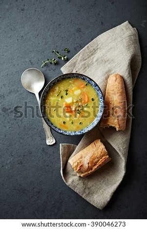 Polish barley soup with fresh marjoram  - stock photo