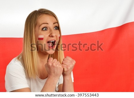 Polish fan cheers football team in the national colors. MANY OTHER PHOTOS FROM THIS SERIES IN MY PORTFOLIO. - stock photo
