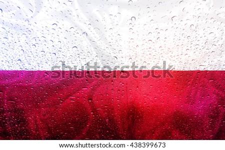 Polish flag with watter drops, rainy weather, Poland - stock photo