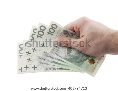 Polish money in hand with clipping path  - stock photo