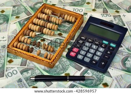 Polish money, pen, abacus on the banknote background - stock photo