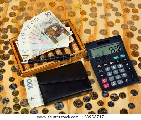 Polish money, pen, wallet, abacus on the coins background - stock photo