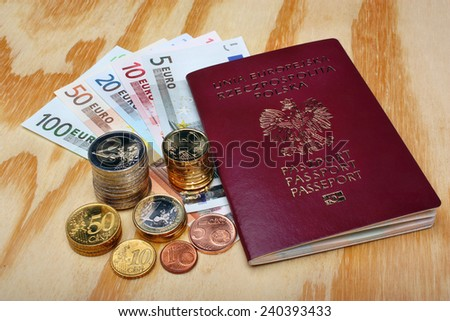Polish passport and euro money  on the table - stock photo