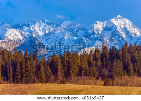 Polish Tatra Mountains Scenery. Mountain Peaks Covered by Snow. Early Spring in the Tatra Mountains. Lesser Poland, Europe. - stock photo
