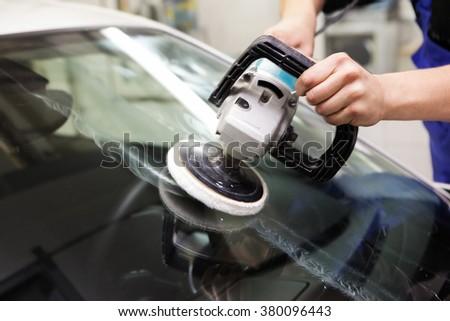 Polishing glass car - stock photo