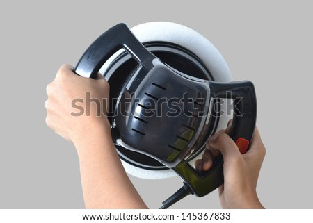 Polishing the car. with power buffer machine . CAR CARE images closeup Useful as background for design-works. - stock photo