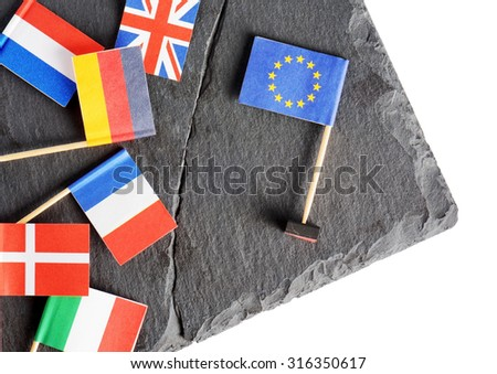 Political concept with small flags of the European Union (EU). Flags of European countries separated by crack from flag of the European Union. - stock photo