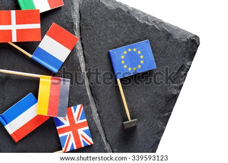 Political concept with small flags of the European Union. Flags of European countries separated by crack from flag of the European Union. - stock photo