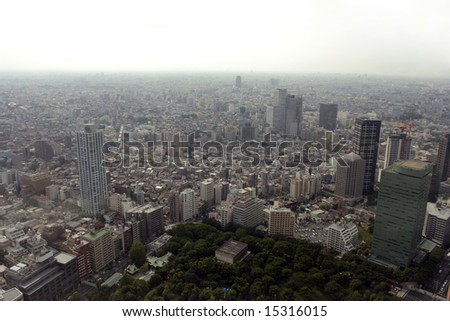 polluted modern megalopolis viewed from the air - stock photo