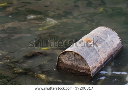Polluted river full of various garbage - stock photo