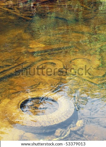 Polluted shallow river - stock photo