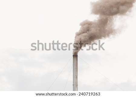pollution coming from factory smoke stacks  - stock photo