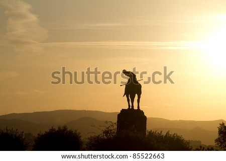 Polo player sunset - stock photo