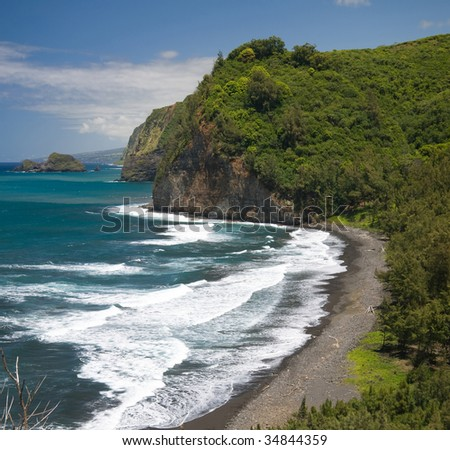 Pololu Valley and its black sand beach on the Northern tip of Hawaii's Big Island. - stock photo