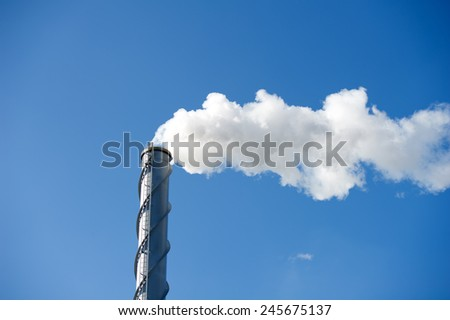 Polution - Chimney poluting the air - stock photo