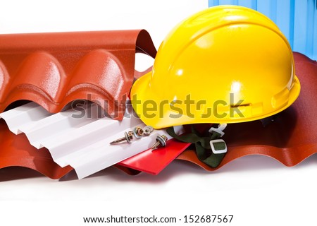 Polycarbonate roof to cover the buildings, screws for mounting, a yellow hard hat on a white background - stock photo