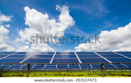 Polycrystalline photovoltaic modules on the background of cloudy sky - stock photo
