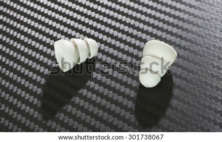 Polymer earpieces that are used with modern electronic hearing protection - stock photo