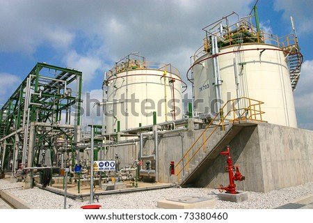 Polymers tanks in the industrial park - stock photo