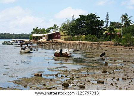Polynesian beach after low tide - stock photo