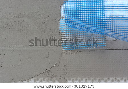 Polystyrene insulation boards covered with mesh covered and mortar - stock photo