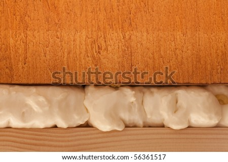 Polyurethane foam fills in gap - stock photo